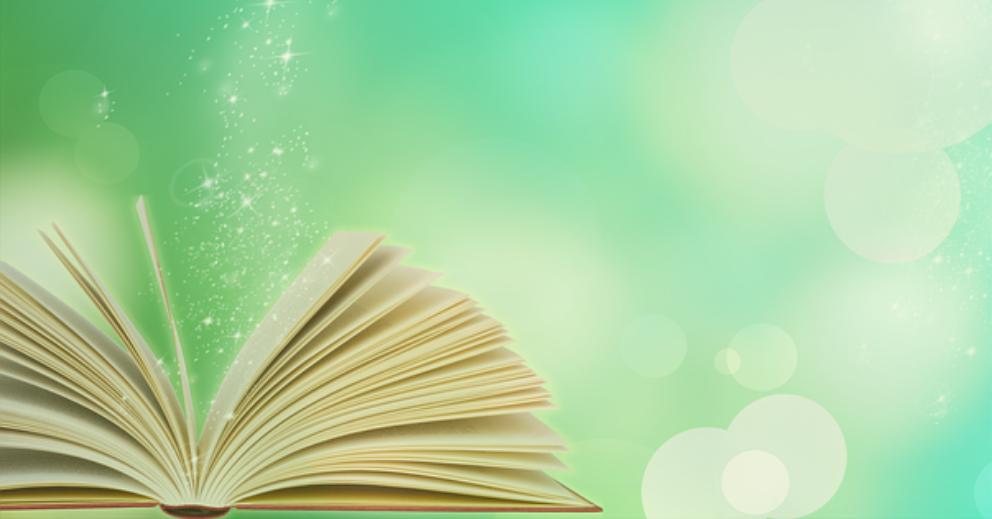 Photo: livre posé à plat, ses pages ouvertes en éventail laissent s'échapper des étoiles